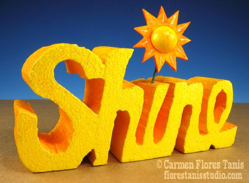 Carved Sunshine Sign by Carmen Flores Tanis